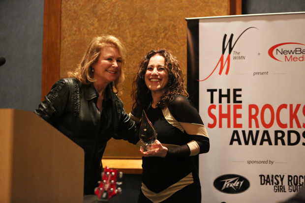 Mary Peavey is awarded the She Rocks Icon award by Laura Whitmore