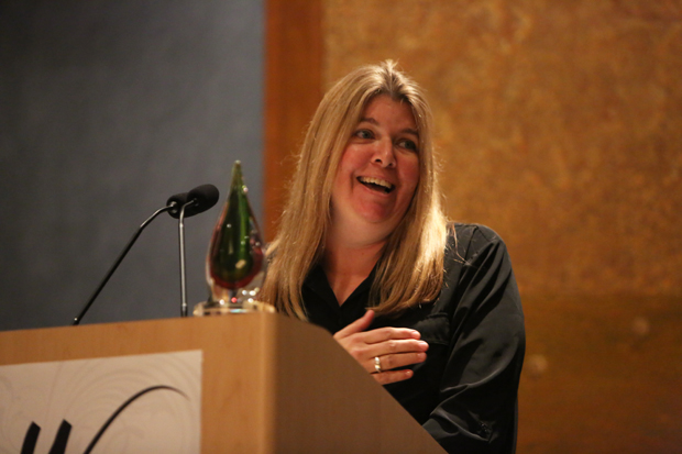 Laura Taylor Sr VP of Operations for Guitar Center is awarded the She Rocks Champion Award