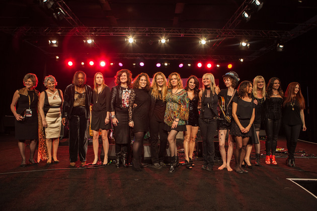 From left: She Rocks Awards winners Debbie Cavalier, Craigie Zildjian, Amani Duncan, Katie Kailus, and Gayle Beacock; She Rocks Awards Founder and Co-Host Laura B. Whitmore; Zepparella drummer Clementine; She Rocks Awards winner and performer Vicki Peterson of The Bangles; guest keyboardist Jenna Paone; She Rocks Awards winner and performer, saxophonist Mindi Abair; Eva Holbrook of SHEL; She Rocks Awards winners and performers Susanna Hoffs and Debbi Peterson of The Bangles; Zepparella bassist Angeline Saris; and Zepparella guitarist Gretchen Menn attend the She Rocks Awards during NAMM at the Anaheim Hilton on January 23, 2015 in Anaheim, California. (Photo by Kevin Graft)